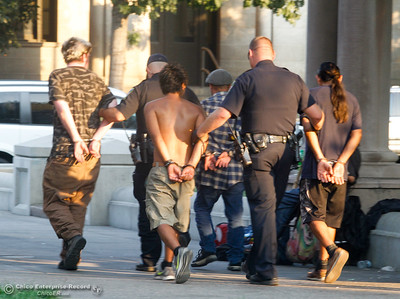 Not quite a National Night Out arrest demonstration but these four people where handcuffed during the event for having outstanding warrants Tuesday August 1, 2017 in Chico, California. (Emily Bertolino -- Enterprise- Record)