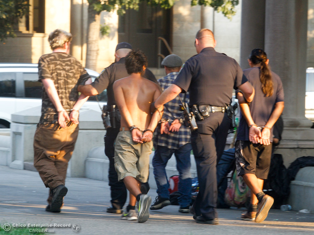. Not quite a National Night Out arrest demonstration but these four people where handcuffed during the event for having outstanding warrants Tuesday August 1, 2017 in Chico, California. (Emily Bertolino -- Enterprise- Record)