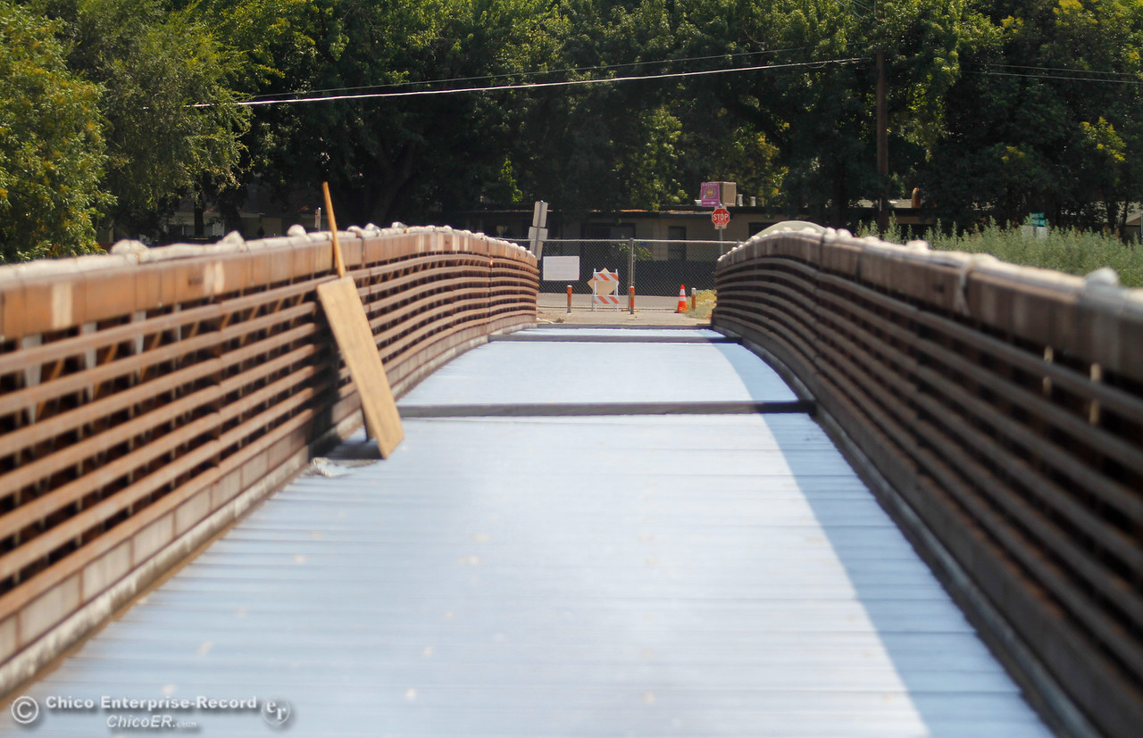 Construction continues on the bike and pedestrian bridge over Lindo Channel between Ceres and Downing avenues in Chico as the wooden deck is being replaced with concrete Thursday August 3, 2017 in Chico, California. (Emily Bertolino -- Enterprise- Record)