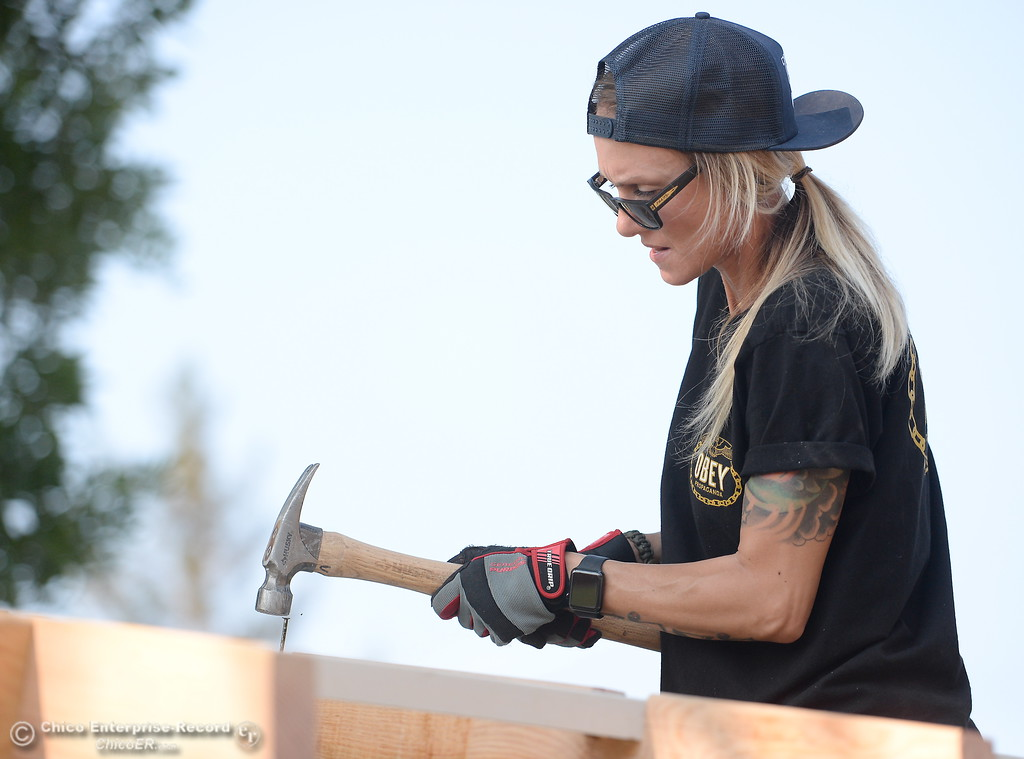 . Christina Haber pounds in a nail while building a shed during the BCOE Construction Bootcamp with Instructor Jack Rodgers at the Silver Dollar Fairgrounds in Chico, Calif. Thurs. Aug. 3 2017. (Bill Husa -- Enterprise-Record)