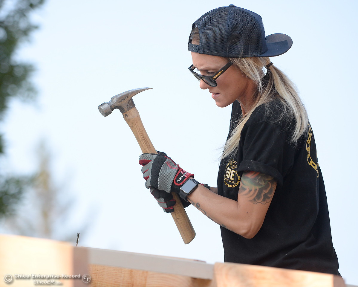 Christina Haber pounds in a nail while building a shed during the BCOE Construction Bootcamp with Instructor Jack Rodgers at the Silver Dollar Fairgrounds in Chico, Calif. Thurs. Aug. 3 2017. (Bill Husa -- Enterprise-Record)