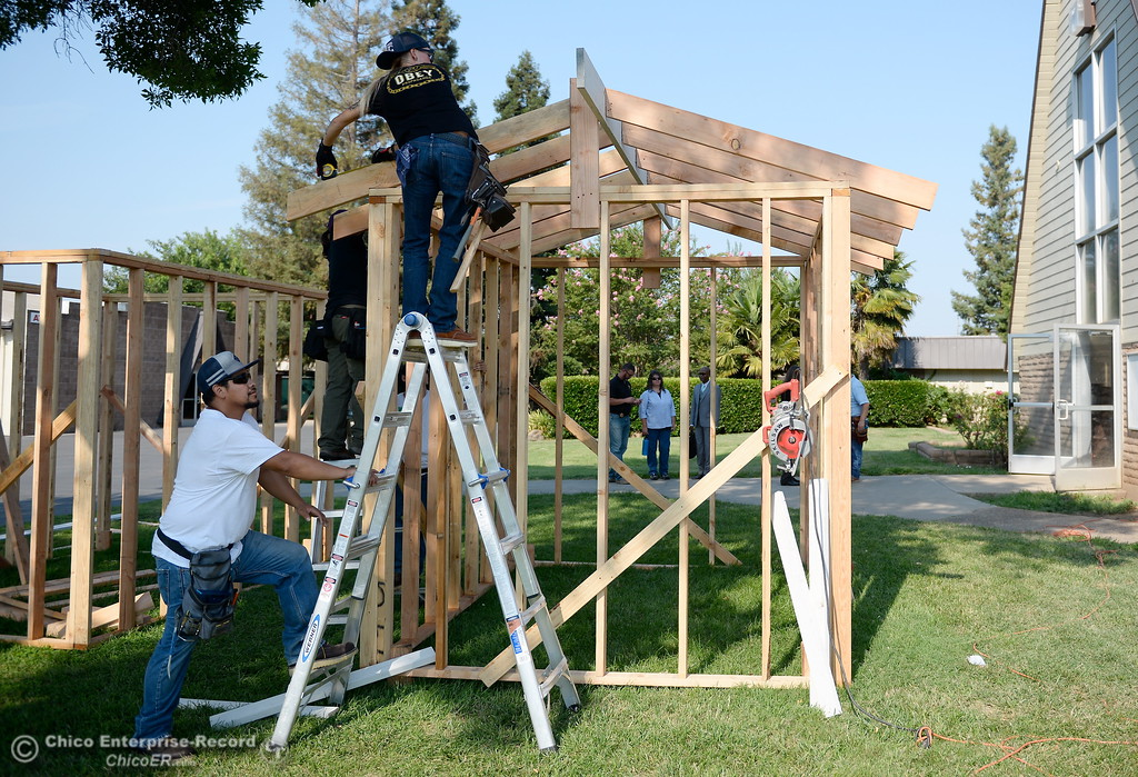 . Israel Gallardo below, and Christina Haber work on a shed during the BCOE Construction Bootcamp with Instructor Jack Rodgers at the Silver Dollar Fairgrounds in Chico, Calif. Thurs. Aug. 3 2017. (Bill Husa -- Enterprise-Record)