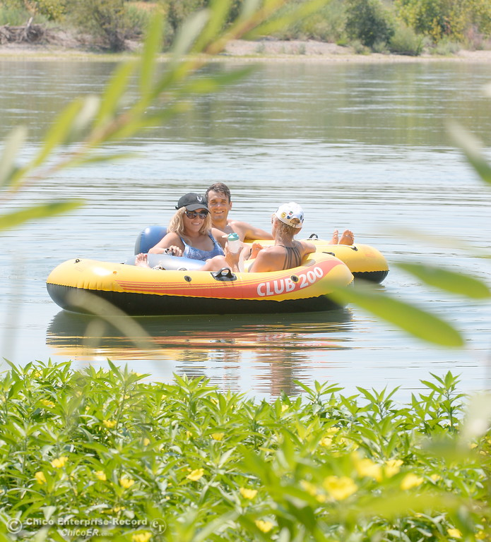. Members of the Skene Family, Haley, Kevin and Denise left to right enjoy a float on the Sacramento River near the Pine Creek inlet Monday July 31, 2017.  (Bill Husa -- Enterprise-Record)