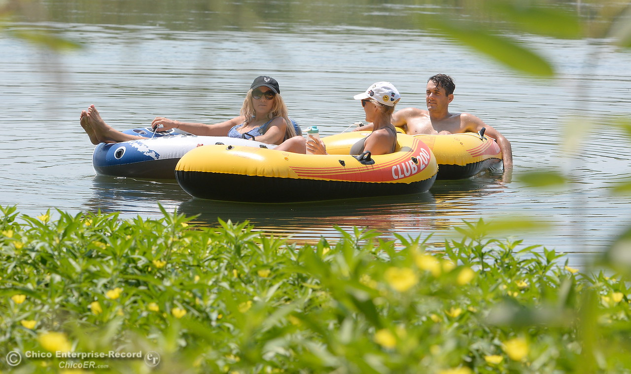 Members of the Skene Family, Haley, Denise and Kevin left to right enjoy a float on the Sacramento River near the Pine Creek inlet Monday July 31, 2017.  (Bill Husa -- Enterprise-Record)