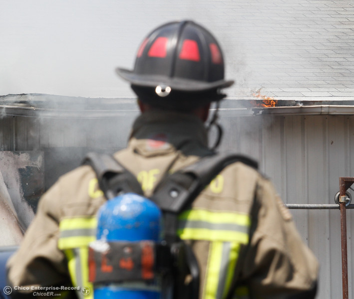 Firefighters work to put out a fire in the wood shop of Square Deal Mattress Factory & Upholstery Tuesday August 1, 2017 along Humboldt Avenue in Chico, California. (Emily Bertolino -- Enterprise- Record)