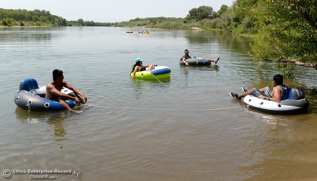 . A group from Chico and Orland enjoy a float on the Sacramento River near the Pine Creek inlet Monday July 31, 2017. Left to right are Mark Bungay, Adriana Pano, Gilberto Rios-Torres and Edwardo Rios left to right.  (Bill Husa -- Enterprise-Record)