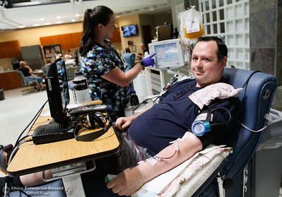 Tim Truitt donates platelets during the 16th Annual Summer Classic Blood Drive August 4, 2017 at BloodSource along Rio Lindo Avenue in Chico, California. Truitt donates every two weeks. Platelets are needed to help during cancer treatments and aid in blood clotting. (Emily Bertolino -- Enterprise- Record)