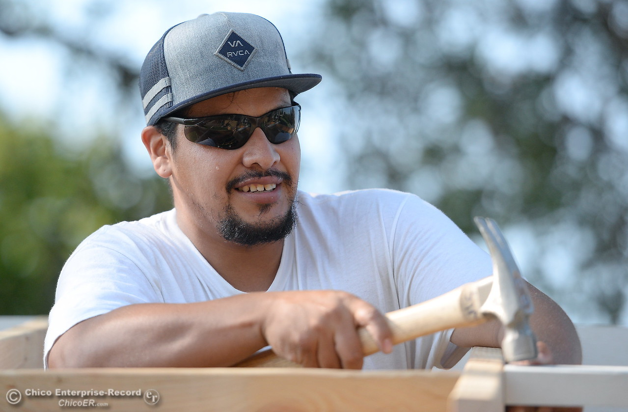Israel Gallardo pounds in a board while building a shed during the BCOE Construction Bootcamp with Instructor Jack Rodgers at the Silver Dollar Fairgrounds in Chico, Calif. Thurs. Aug. 3 2017. (Bill Husa -- Enterprise-Record)