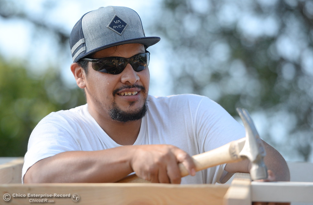 . Israel Gallardo pounds in a board while building a shed during the BCOE Construction Bootcamp with Instructor Jack Rodgers at the Silver Dollar Fairgrounds in Chico, Calif. Thurs. Aug. 3 2017. (Bill Husa -- Enterprise-Record)