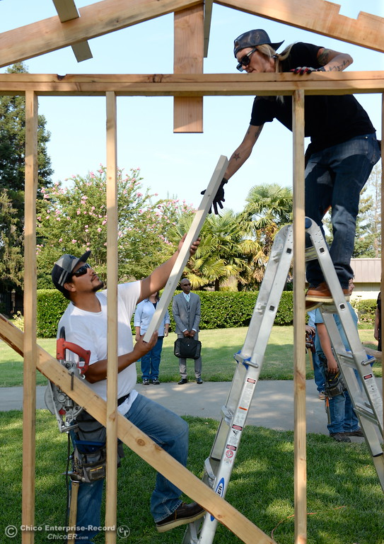 . Israel Gallardo left and Christina Haber work on a shed during the BCOE Construction Bootcamp with Instructor Jack Rodgers at the Silver Dollar Fairgrounds in Chico, Calif. Thurs. Aug. 3 2017. (Bill Husa -- Enterprise-Record)