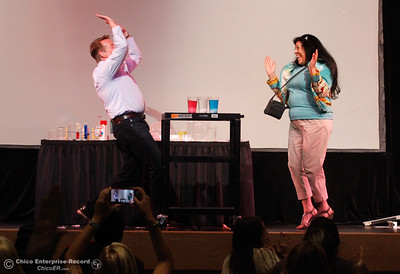 "Steve Spangler and Gloria Halley celebrate after Halley successfully knocked three eggs into three separate glasses of water as Spangler goes over fun science activies educators can do with their students during  ìLearning Rocks: the 10th Annual Expanded Learning Institute"" August 3, 2016 at the Bell Memorial Union on the Chico State campus in Chico, Calif. (Emily Bertolino -- Enterprise-Record)"