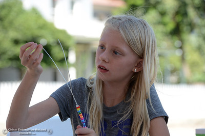 Zoe Hess, 9, creates a bubble wand as Patrick Ranch hosts a water workshop for children Saturday, Aug. 6, 2016, in Durham, California. (Dan Reidel -- Enterprise-Record)
