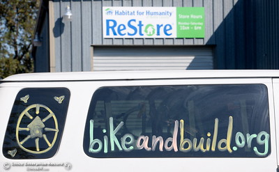 A van is parked out in front as 35 young adults from Bike & Build help organize tiles, scaffolding and build racks at the Habitat for Humanity ReStore on Meyers St. in Chico, Calif. Thurs. Aug. 4, 2016. (Bill Husa -- Enterprise-Record)
