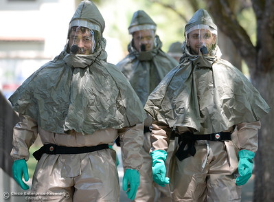 Enloe Medical Center Technicians learn how to properly decontaminate patients and themselves while wearing protective gear during a code orange drill at Enloe Medical Center in Chico, Calif. Wed. Aug. 3, 2016. (Bill Husa -- Enterprise-Record)