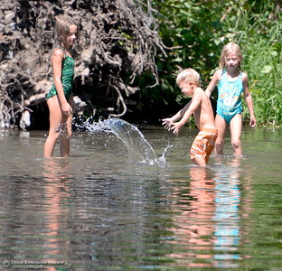 The Smith Family children of Chico Angelina, 8, Alyssa, 6, and Cole, 3, enjoy staying cool in the shallow water in Big Chico Creek near the Five Mile Recreation Area at Bidwell Park in Chico, Calif. Mon. Aug. 1, 2016. (Bill Husa -- Enterprise-Record)
