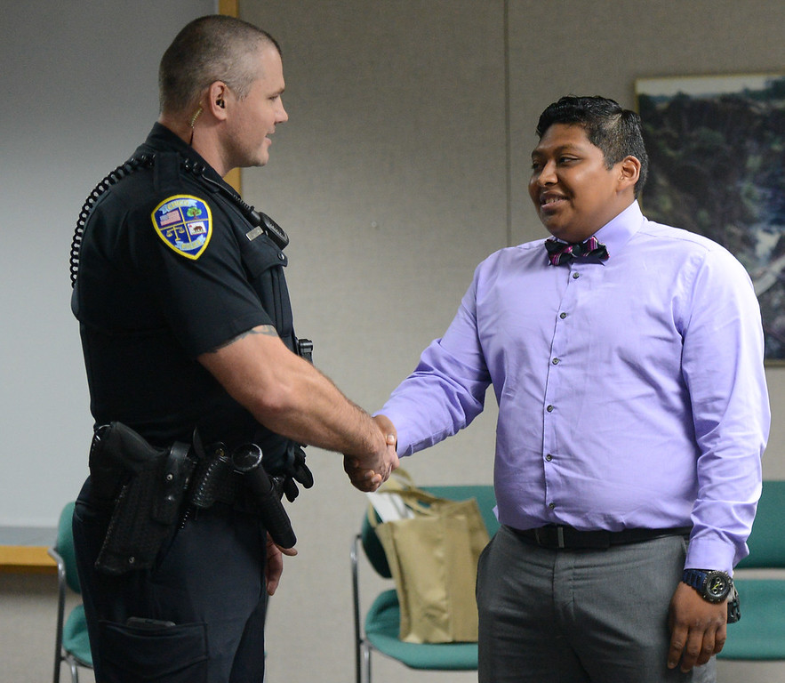 . Chico police officer Cedric Schwyzer shakes hands with Steven Huerta, a young man whose life changed for the better when Schwyzer recognized Huerta was involved in gang activity and needed a positive male role model Friday September 8, 2017  in Chico, California. (Emily Bertolino -- Enterprise-Record)