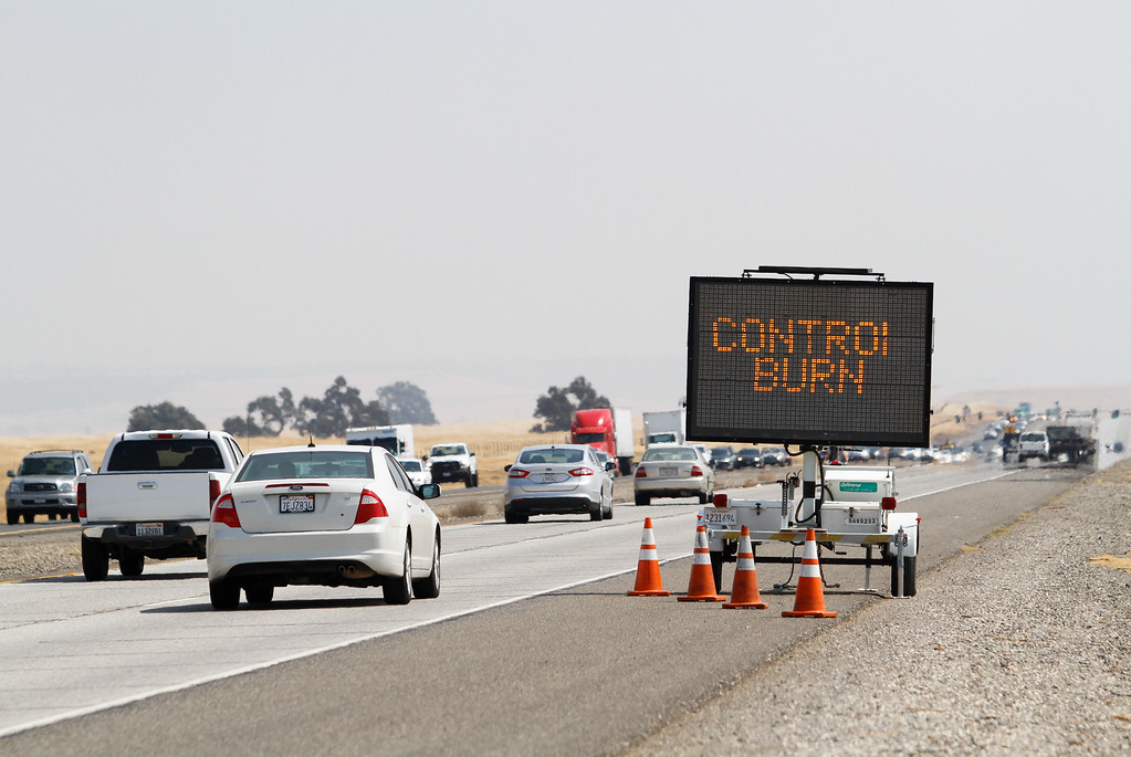 ". A sign reads, ""Control Burn In Process,\"" along Highway 99 near Neal Road Wednesday September 6, 2017 in Chico, California. (Emily Bertolino -- Enterprise-Record)"