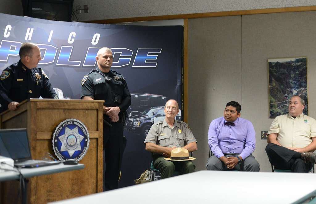 . Chico Police Chief Mike O\'Brien leads a community policing conference where he names the employee, Cedric Schwyzer with Lassen Volcanic National Park superintendent James Richardson, Chico Parks department employee Steven Huerta and Chico Park Services Coordinator Shane Romain in attendance Friday September 8, 2017  in Chico, California. (Emily Bertolino -- Enterprise-Record)