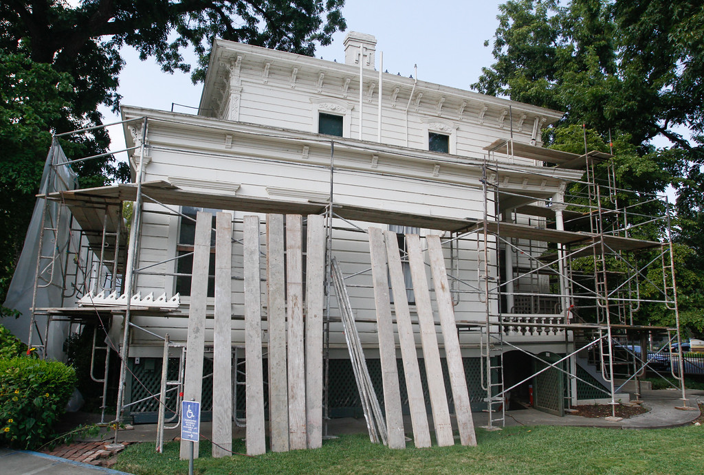 . Thursday crews worked to scrape away old paint in preparation for a new coat on the Stansbury Home in a manner that will preserve it\'s historic significance September 6, 2017 in Chico, California. (Emily Bertolino -- Enterprise-Record)