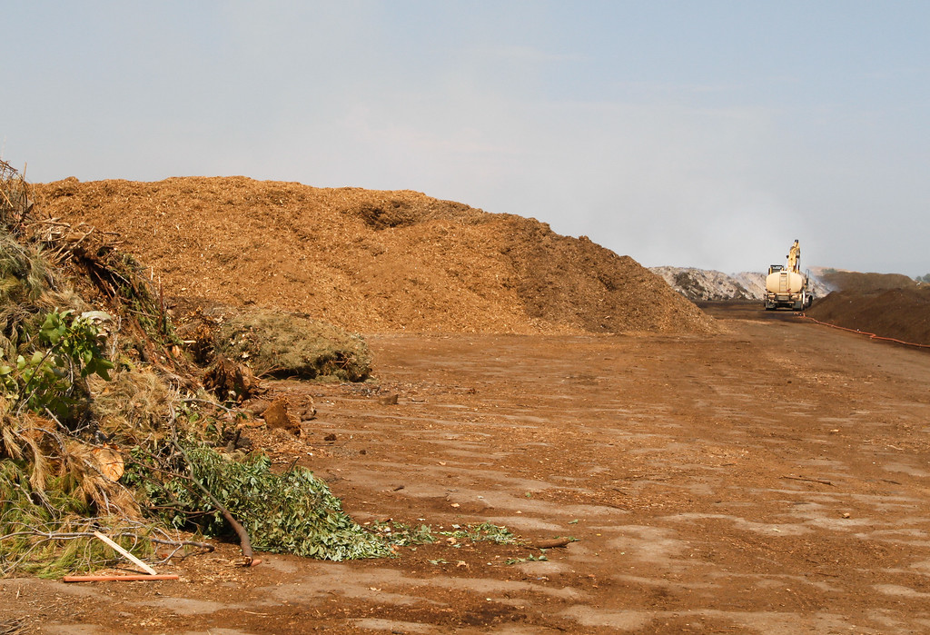 . Different levels of green waste lead up to the smoldering pile in the center back right Wednesday September 6, 2017 at Old Durham Wood in Durham, California. (Emily Bertolino -- Enterprise-Record)