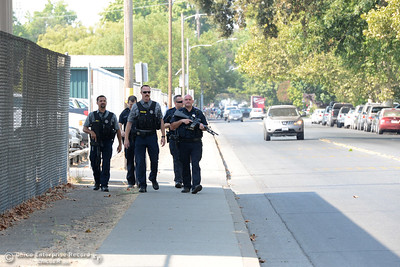 Chico police finish clearing the football, softball and baseball fields Tuesday, Sept. 6, 2016, at Chico High and walk along West Sacramento Avenue in Chico, California. (Dan Reidel -- Enterprise-Record)