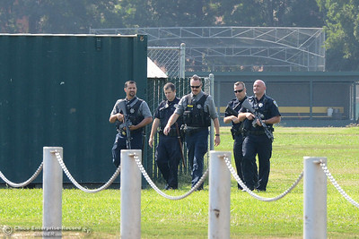 Chico police walk Tuesday, Sept. 6, 2016, after clearing the football, softball and baseball fields at Chico High in Chico, California. (Dan Reidel -- Enterprise-Record)