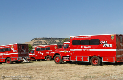A fleet of Cal Fire Fire Crew vehicles line up in preparation of heading back out onto the Saddle Fire line September 7, 2016 at the Forebay in Oroville, Calif. (Emily Bertolino -- Enterprise-Record)
