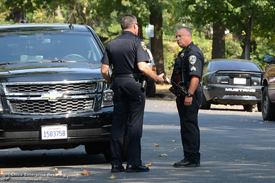 Chico police Lt. Ted McKinnon, left, issues orders to Sgt. Cesar Sandoval, right, after Sandoval's crew cleared the Chico High parking lot Tuesday, Sept. 6, 2016, in Chico, California. Police were responding to a call that said a man with a gun may be entering the school. (Dan Reidel -- Enterprise-Record)