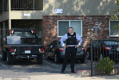 Chico Police Department Detective Peter Durfee watches people and vehicles pass by an apartment complex Tuesday, Sept. 6, 2016, in the area that a man with a gun was reported in Chico, California. (Dan Reidel -- Enterprise-Record)