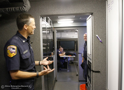 Inside the Cal Fire Mobile Communication Center, Shasta-Trinity Fire Captain Syle Johnson talks with Butte County Division Chief Jamie Norton about the center's amazing technology September 7, 2016 at the Forebay in Oroville, Calif. (Emily Bertolino -- Enterprise-Record)