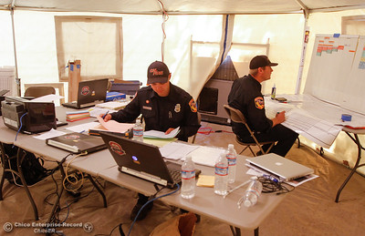 Cal Fire Butte County firefighters Joey Panzella and Jordan Weber communicate with firefighters working in the field, on the Saddle Fire's line to plan for tomorrows attack September 7, 2016 at the Afterbay in Oroville, Calif. (Emily Bertolino -- Enterprise-Record)