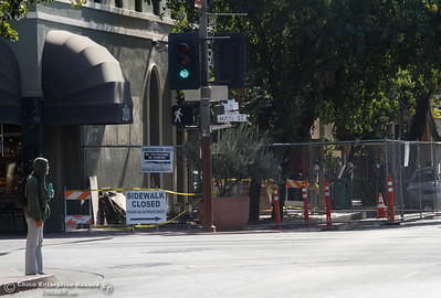Gates surrounded a small portion of the sidewalk on West 2nd Avenue in front of Zucchini & Vine as construction ensues September 13, 2016  in Chico Calif. (Emily Bertolino -- Enterprise-Record)