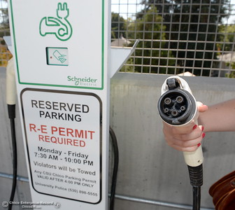 The plug for an electric vehicle charging station is seen at a CSUC charging station in Chico, Calif. Thursday Sept. 15, 2016. (Bill Husa -- Enterprise-Record)