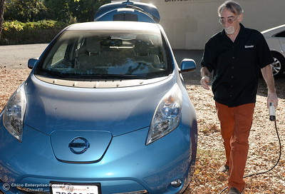 Electric vehicle owner Matt York of Chico shows how he plugs in his 2014 Nissan Leaf as he demonstrates some of the features of his electric vehicle Thursday Sept. 15, 2016. (Bill Husa -- Enterprise-Record)