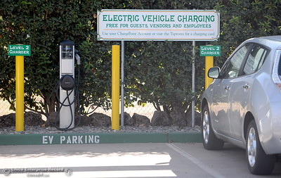 A vehicle gets a charge at an electric vehicle charging station at Sierra Nevade Brewery in Chico, Calif. Thursday Sept. 15, 2016. (Bill Husa -- Enterprise-Record)