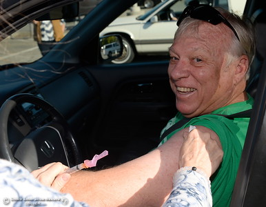 Cliff Neill of Chico smiles as he gets vaccinated during the annual Enloe drive through flu clinic held at the Calvary Chapel parking lot in Chico, Calif. Thurs. Sept. 22, 2016. Last year they administered 1,145 vaccines to people during the clinic in one day. (Bill Husa -- Enterprise-Record)