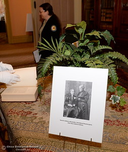 A photo of Susan B. Anthony with another mansion guest Mary Stafford Anthony sits on a table in the library seen during a tour of the Bidwell Mansion in Chico, Calif. Thurs. Sept. 22, 2016.  (Bill Husa -- Enterprise-Record)