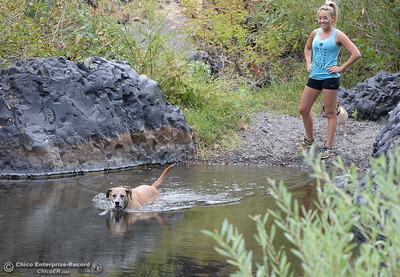 Sara Brown of Paradise smiles as she watches her dog Achilles go for a swim near Bear Hole in Upper Bidwell Park on the last full day of the summer season in Chico, Calif. Wednesday Sept. 21, 2016.  (Bill Husa -- Enterprise-Record)