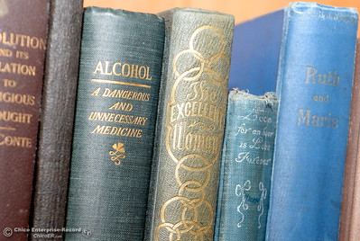 """A book titled """"Alcohol A Dangerous and Unnecessary Medicine"""" is seen in the Bidwell Mansion Library during a tour of the Bidwell Mansion in Chico, Calif. Thurs. Sept. 22, 2016.  (Bill Husa -- Enterprise-Record)"""