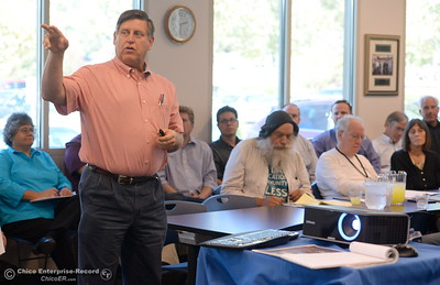 Robert Marbut, homeless consultant expert talks with representatives of helpers of the homeless within the community during a meeting at the County Housing Authority office in Chico Calif. Friday Sept. 23, 2016. (Bill Husa -- Enterprise-Record)