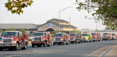 Fire trucks as far as the eye can see are lined up to turn left onto Park Ave. from Dr. Martin Luther King Jr. Parkway in Chico, Calif. Friday morning enroute to the Ponderosa Fire. (Bill Husa -- Enterprise-Record)