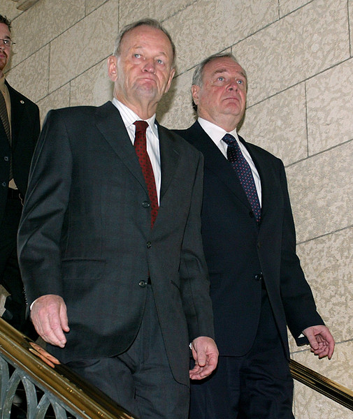 Prime Minister of Canada, Jean Chretien (L), and Liberal party leader, Paul Martin (R), descend the stairs from Chretien's office to talk to reporters in Ottawa Tuesday, November 18, 2003. It was announced that Chretien will retire on December 12, 2003 and Martin will become Prime Minister. Photo by Patrick Doyle.