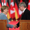 German Chancellor Angela Merkel shakes hands with Canadian Prime Minister Stephen Harper after a joint press conference on Parliament Hill in Ottawa, Thursday, August 16, 2012. Photo by Patrick Doyle.