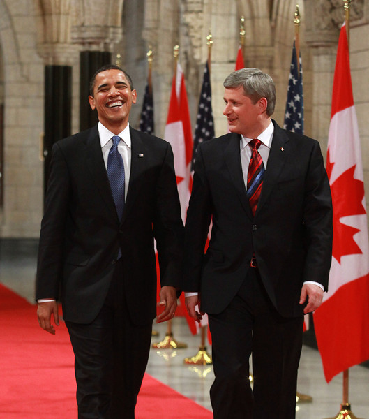 U.S. President Barack Obama, left, laughs as he arrives at a joint press conference with Stephen Harper, Prime Minister of Canada, in Ottawa, Ontario, Canada, Thursday, Feb. 19, 2009.   Photographer: Patrick Doyle