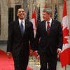 U.S. President Barack Obama, left, laughs as he arrives at a joint press conference with Stephen Harper, Prime Minister of Canada, in Ottawa, Ontario, Canada, Thursday, Feb. 19, 2009.  <br /> Photographer: Patrick Doyle