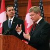 U.S. President Barack Obama, left, watches Stephen Harper, Prime Minister of Canada, answer a question from reporters at a joint press conference in Ottawa, Ontario, Canada, Thursday, Feb. 19, 2009.  <br /> Photographer: Patrick Doyle