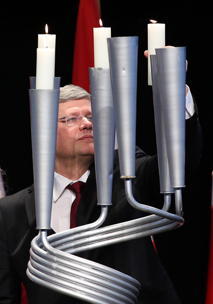 Canada's Prime Minister Stephen Harper places a candle in a Yad Vashem candelabra at the National Holocaust Remembrance Day Ceremony at the Canadian War Museum in Ottawa, April 23, 2012. Photo by Patrick Doyle   (CANADA)