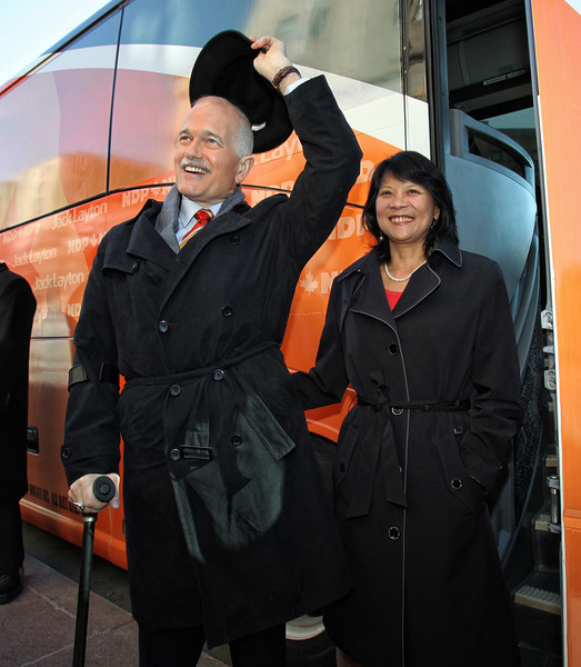 New Democratic Party (NDP) leader Jack Layton (L) raises his hat as he and his wife, Ontario Member of Parliament Olivia Chow, board Layton's bus to begin his election campaign after a rally in Ottawa, March 26, 2011. Photo by Patrick Doyle.