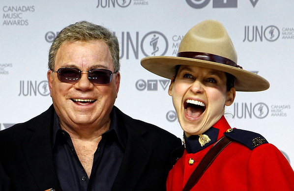 Host William Shatnerposes on the red carpet with a member of the Royal Canadian Mounted Police during the 41st Juno Awards in Ottawa April 1, 2012. Photo by Patrick Doyle.