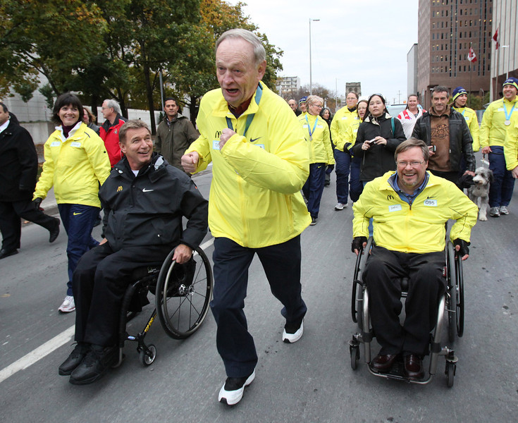 "Former Prime Minister Jean Chretien runs with Rick Hansen (L) on his ""Many in Motion Tour"""